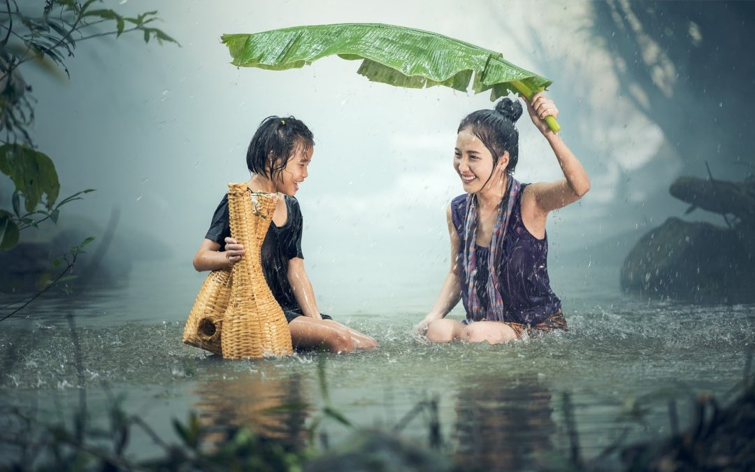Image of young girls being happy in the rain